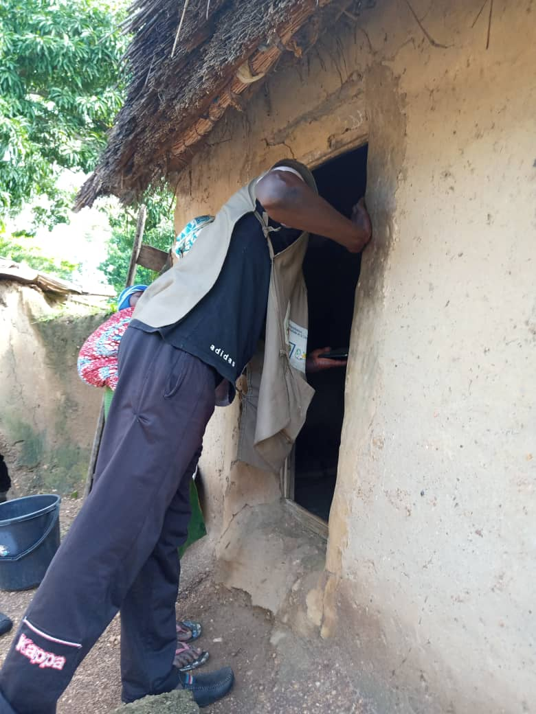 A data collector gains permission to enter a household to examine nets hung and their condition