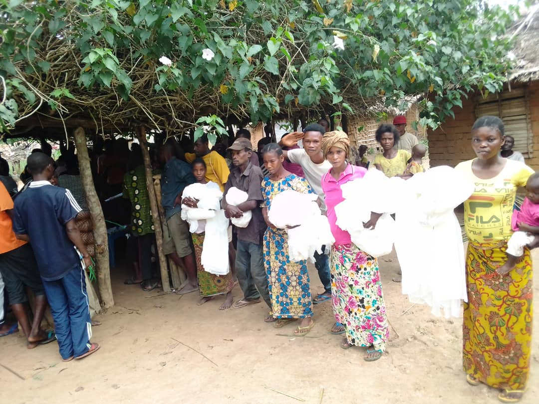 Community members who have received their mosquito nets